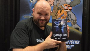 Matt Kadish with his book Earthman Jack vs The Ghost Planet