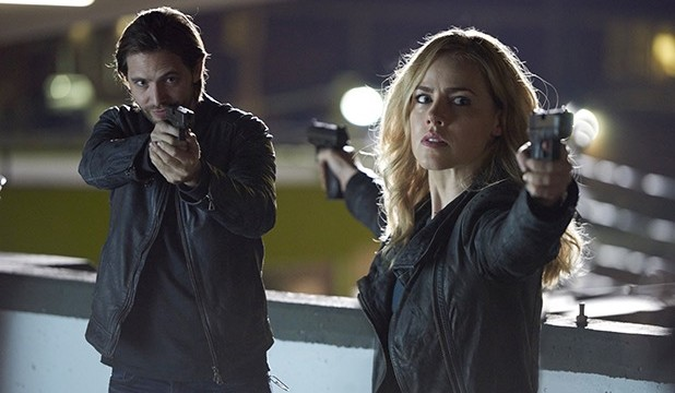 """12 MONKEYS -- """"Year of the Monkey"""" Episode 201 -- Pictured: (l-r) Aaron Stanford as James Cole, Amanda Schull as Cassandra Railly -- (Photo by: Steve Wilkie/Syfy)"""